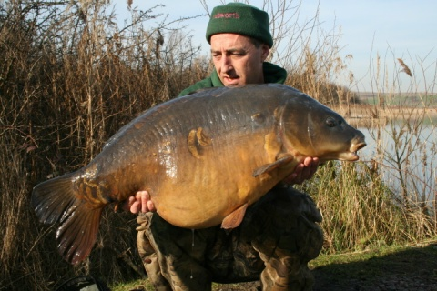 Martin Clarke with a huge 40 pound plus mirror carp caught off the top