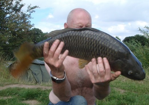 Carp jumps out of hands and lands safely on an unhooking mat!